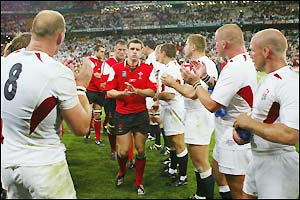 The England team clap the Wales players off the field