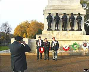 Old soldiers take their own souvenir photograph at the Guards Memorial at Horse Guards Parade