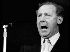 Hugh Gaitskell speaking at microphone