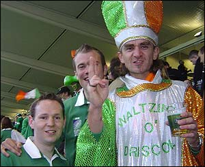Irish supporters in action against Romania