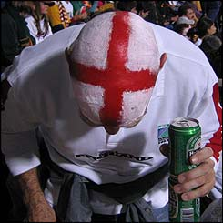 An England fan sporting a George's Cross on their head