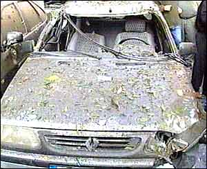 Wrecked car after blast