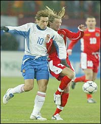 Wales Robbie Savage tangles for the ball with Russia's Alexander Mostovoi