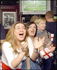 England fans watch the match in a pub in London