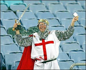 An England fan dressed as a medieval solider celebrates victory