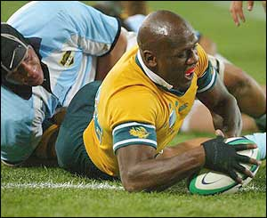 Australia's Wendell Sailor scores a try against Argentina