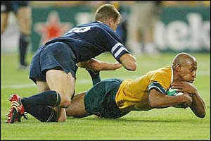Captain George Gregan scores for Australia against Scotland