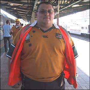 An Australian railway employee shows off his Wallaby shirt