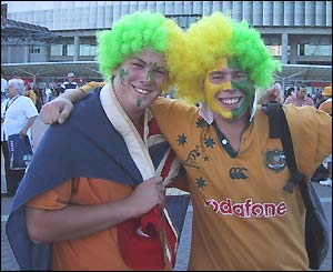 Australian fans with painted faces celebrate outside the Telstra Stadium
