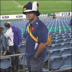 A lone French fan looks sad as he leaves the stadium