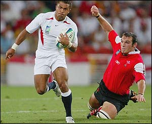 Jason Robinson breaks away for England in the quarter-final clash with Wales