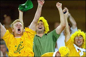 Australian fans celebrate in the Telstra stadium