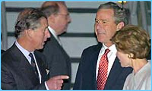 George Bush is greeted by Prince Charles
