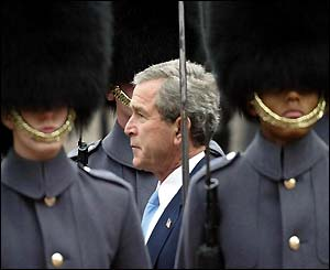 President Bush carries out an inspection of the guards