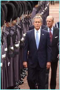 The Duke of Edinburgh and Mr Bush inspect the Queen's guards.