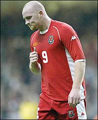 Wales' John Hartson is disappointed after the match