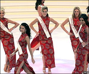 Contestants in traditional Chinese dresses dance at the opening ceremony of the Miss World contest
