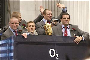 Martin Johnson and his team set off on their victory parade