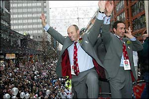 England coach Clive Woodward  celebrates with fans