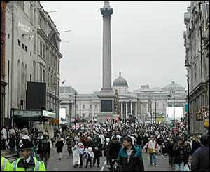 Fans leave Trafalgar Square after the celebration