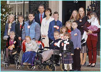 Prime Minister Tony Blair and his wife Cherie are photographed with the brave children outside 10 Downing Street on Wednesday