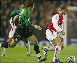 Dennis Bergkamp launches an Arsenal attack