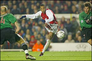 Thierry Henry fires a shot narrowly wide