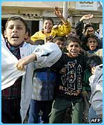 Iraqi children celebrate the capture of ousted dictator Saddam Hussein