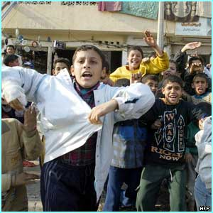 As the news spreads the children in Baghdad are overjoyed and take to the streets to celebrate