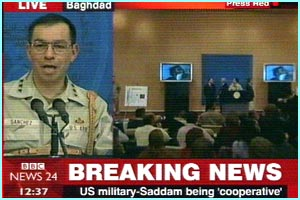Lots of journalists attended a Press Conference where the dramatic story of Saddam's capture unfolded