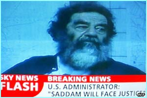 Saddam's capture by the US military is broadcast on TV all around the world