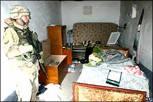 The bedroom of the mud hut where Saddam Hussein was staying when he was caught