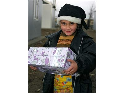 Girl with her shoebox