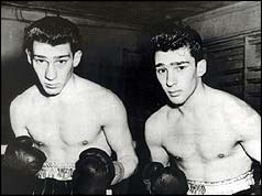 Ronnie and Reggie Kray in boxing shorts