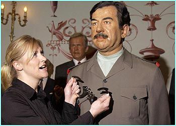 Saddam Hussain's waxwork at Madame Tussauds in London gets some new accessories!