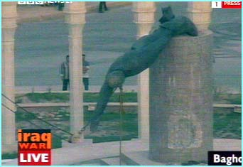 Statue of Saddam Hussein is pulled to the ground
