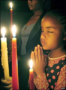 Kenyan girl lights candles
