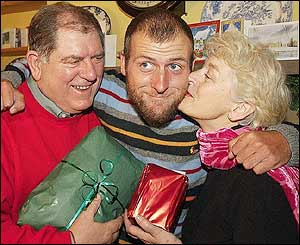 Mark Henderson gives his parents a Christmas hug