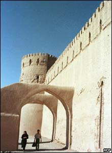Tourists walk through arches at the citadel before the earthquake