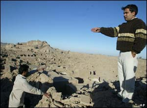 An Iranian man stands among the ruins in the devastated city of Bam