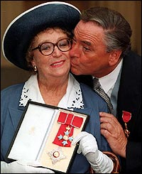 Bob Monkhouse with Dame Thora Hird at Buckingham Palace in 1993