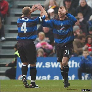 Tommy Johnson celebrates scoring Gillingham's first goal