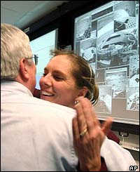 As the first images are beamed through colleagues at Nasa's Jet Propulsion Laboratory in Pasadena, California celebrate