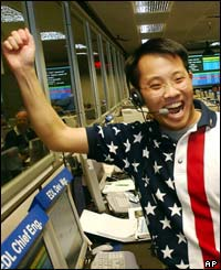 Landing Chief Engineer Wayne Lee whoops for joy  as the signal from the Mars Rover Spirit is received.