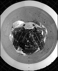 The pictures show the barren, rock-strewn landscape surrounding the Spirit lander