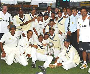 The Indian team pose with the Border-Gavaskar series trophy, which they retain after the series is drawn