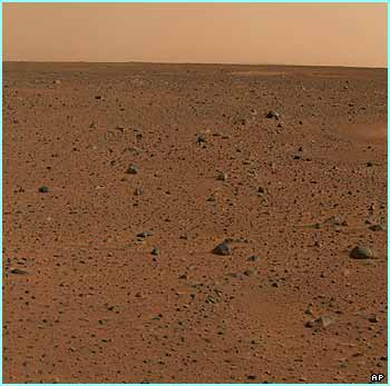 This is the first colour image sent back from Mars by the robotic probe Spirit. It's actually made up of lots of different images stuck together by Nasa