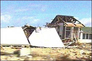 Houses destroyed by the  cyclone on Niue
