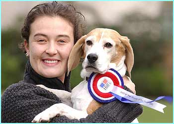 Megan gets a hug from her proud owner, for her achievement in winning the battle against doggie obesity