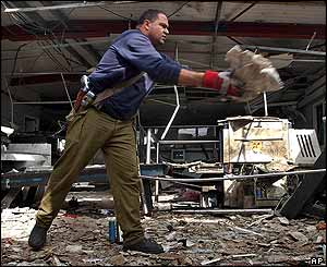 Israeli security officer removes debris